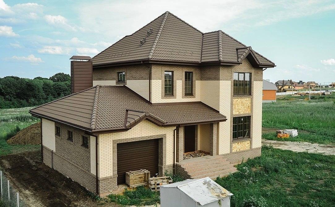 Дом из пеноблоков с наружной кирпичной отделкой